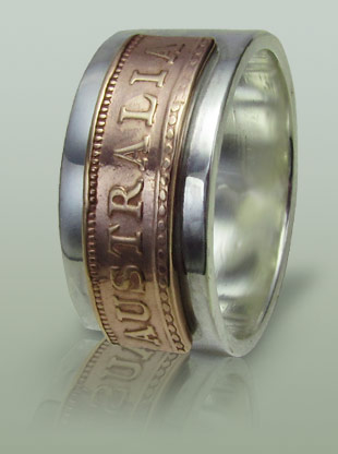 Mans ring in silver with fragment from an Australian penny