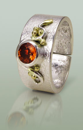 Sterling silver ring with orange Sapphire