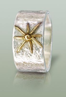 Mans silver ring with star motif in 18K gold